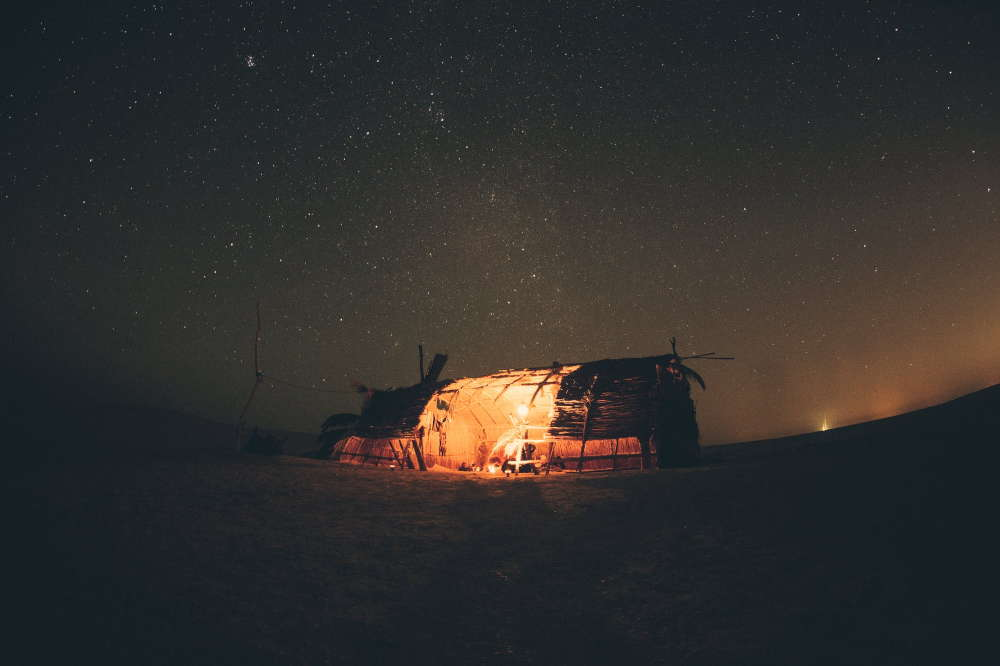 primitive camping tent in the night